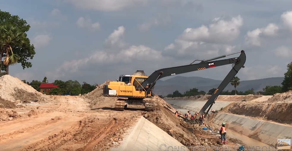 Long Reach Excavator Digging Making Canal In Cambodia